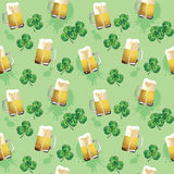Seamless texture with leaves of clovers and beer mugs. Vector seamless texture with leaves of clovers and beer mugs on a light green background Royalty Free Stock Photo