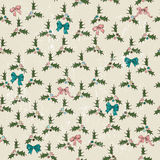 Seamless texture with mistletoe and bows. Stock Photography