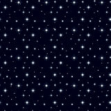 Seamless texture night sky with lots of stars 2. Celestial seamless background with multiple sparkling stars glittering on dark blue sky in the night Stock Photo