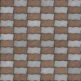 Seamless Texture of Pavement as Wavy Parallelogram. Brown and Gray Paving Slabs as Wavy Parallelograms Laid in Chequerwise. Seamless Tileable Texture Royalty Free Stock Photos