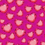 Seamless texture with pink hearts. In the form of diamonds Stock Photos