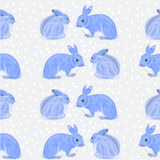 Seamless texture rabbits and snow vector Stock Photos