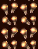 Seamless texture with realistic light bulbs and light. Stock Images
