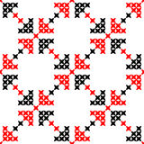 Seamless texture with red and black abstract flowers. Seamless texture with red and black abstract patterns for tablecloth. Embroidery. Cross stitch Royalty Free Stock Image