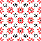 Seamless texture with red and black abstract flowers. Seamless texture with red and black abstract patterns for tablecloth.Embroidery.Cross stitch Stock Photos