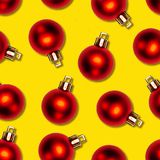 Seamless texture of red Christmas balls on yellow background Royalty Free Stock Photos