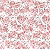 Seamless texture with red contours of the doodle hearts Royalty Free Stock Image