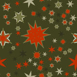 Seamless texture red on dark green stylized flowers and stars. Red on dark green Seamless texture with stylized flowers and stars Stock Image