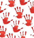 Seamless texture with red prints of children`s hands Royalty Free Stock Image