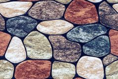Seamless texture of rounded multi-colored marble stones. Stone wall finish with rounded edges stock images