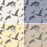 Seamless texture with silhouettes flying cranes. Four seamless texture with silhouettes flying cranes stock illustration
