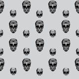 Seamless texture skull on gray background Stock Photos