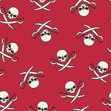 Seamless texture with skulls and pirate swords Royalty Free Stock Photos