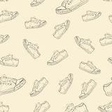 Seamless texture with sneakers Stock Image