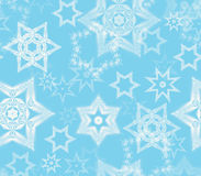 Seamless texture with snowflake fractal ornaments in light blue and white glitter. Stock Image