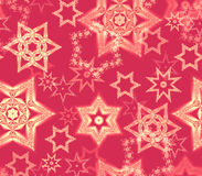 Seamless texture with snowflake fractal ornaments in red and pale gold glitter. Consists of many snowflakes of several shapes and sizes. Suitable as wrapping Stock Photos