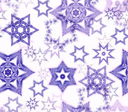Seamless texture with snowflake fractal ornaments in violet glitter on white. Consists of many snowflakes of several shapes and sizes. Suitable as wrapping Royalty Free Stock Images