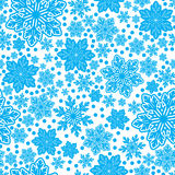 Seamless texture of snowflakes in vector design. Seamless pattern of blue snowflakes of different sizes in vector design Royalty Free Illustration