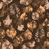 Seamless texture with stamped autumn leaves Stock Photos