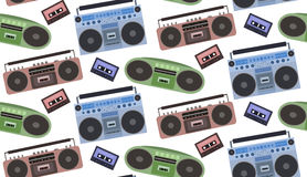 Seamless texture with tape recorders and cassette tapes. Stock Photo