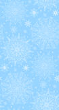 Seamless texture with tracery winter snowflakes Stock Photography