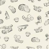 Seamless texture of video cameras 3. Seamless texture of sketches of different video cameras Stock Photo