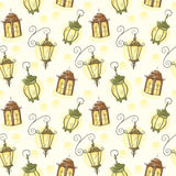 Seamless texture vintage lanterns on a light background. Vector seamless texture with vintage lanterns on light yellow background Royalty Free Stock Photo