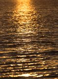 Seamless texture warm color shining sunset water surface Stock Image