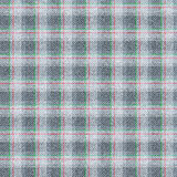 Seamless texture of wool fabric in a cage. Grey material with thin strips of red and green. Royalty Free Stock Photos
