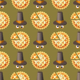 Seamless Thanksgiving day pattern with pumpkin pie and hat. Royalty Free Stock Photos