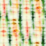 Tie Dye Background. Seamless tie-dye pattern of green and orange color on white silk. Hand painting fabrics - nodular batik. Shibori dyeing royalty free illustration