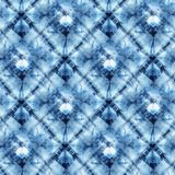 Seamless tie-dye pattern of indigo color. On white silk. Hand painting fabrics - nodular batik. Shibori dyeing Stock Image