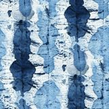 Tie Dye Background. Seamless tie-dye pattern of indigo color on white silk. Hand painting fabrics - nodular batik. Shibori dyeing royalty free illustration