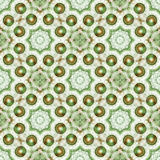 Seamless tile with green and brown pearls and a white lacy pattern Royalty Free Stock Images