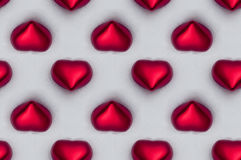 Seamless tile of red hearts in the snow Royalty Free Stock Images