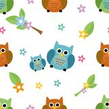 Seamless tiling cute and colorful texture with owls. And flowers Royalty Free Stock Image