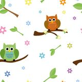 Seamless tiling texture with owls and flowers Stock Photography