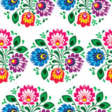 Seamless traditional floral pattern from Poland. Repetitive colorful pattern on black background - Polish folk art print Wzory Lowickie stock illustration