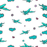 Seamless travel pattern. Cute doodle pattern with blue airplanes. Flying airplanes. Traveling background Stock Photos