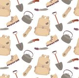 Seamless travelling camping hiking pattern. Cartoon illustartion boot rope knife kettle teapot shovel Royalty Free Stock Image