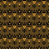Seamless tribal pattern of triangular geometric elements. Abstract ethnic vector print. Black, orange, brown colors Royalty Free Stock Image