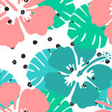 Seamless tropical floral pattern background. Hibiscus flower on black and white polka dot background, seamless pattern Stock Photography