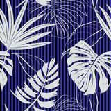 Seamless tropical leaves with flowers on a striped background. Vector background for textile design Royalty Free Stock Image