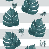 Seamless tropical leaves pattern on stripes background. Greens l Royalty Free Stock Photo