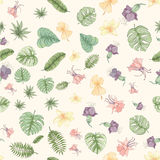 Seamless tropical palm leaves and flowers pattern Stock Photo