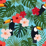Seamless Tropical Pattern, Monstera And Palm Leaves, Bright Chinese Rose Flowers, Toucan Birds On A Blue Background. Royalty Free Stock Photos