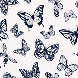 Seamless two-tone pattern with silhouettes of butterflies. Vector illustration. Stock Photos