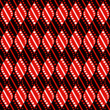 Seamless vector abstract pattern. Geometric symmetrical repeating background in black and red colors. Stock Photo