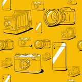 Seamless vector background with cameras Stock Photography