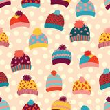 Seamless vector background knitted wool hats. Warm winter clothes wear pattern. Hand drawn cozy and warm accessories. Scandinavian stock illustration